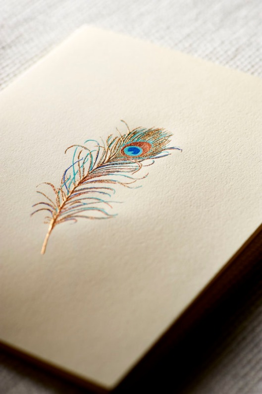 gold engraved peacock feather notes