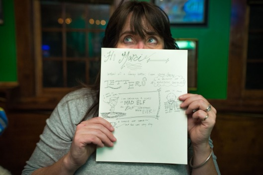Tara McCray holds up her almost finished letter. (Maria Pouchnikova)